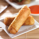 Chinese egg rolls with sauce on plate Royalty Free Stock Photos