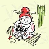 Chinese in einem roten Kopfschmuck, sitzend auf einer Matte mit einer Katze auf seinen Knien Stockbilder
