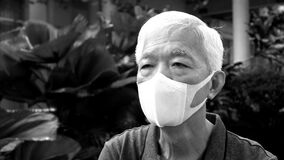 Chinese elderly man wearing mask N95 protect from Coronavirus infection black and white