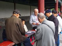 Chinese Elderly plays card game at the Temple of Heaven. Travel royalty free stock photos