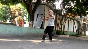 Chinese elderly practice Taijiquan Exercise stock footage