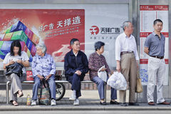 Chinese elderly waiting at a bus stop, Shanghai, China Royalty Free Stock Image