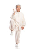 Chinese Elderly Woman Performing Tai Chi Stock Photo