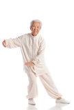 Chinese Elderly Woman Performing Tai Chi Royalty Free Stock Photo