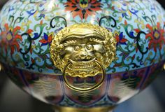 Chinese enamel handycraft with golden decoration Stock Photos