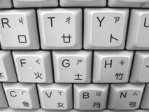 Chinese-English Computer Keyboard. Next to the English letters you can see the romanization symbols and the Chinese radicals Royalty Free Stock Photography