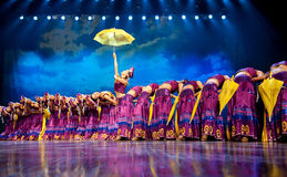 Chinese ethnic dance of Yi nationality. Chinese Yi ethnic dance performed by song and dance troupe of Liangshan Yi autonomous prefecture at JIAOZI theater in the Stock Photos