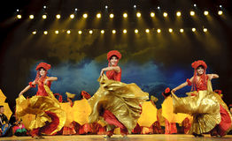 Chinese ethnic dancers of Yi nationality. CHENGDU - SEP 26: chinese Yi ethnic dance performed by song and dance troupe of Liangshan Yi autonomous prefecture at Stock Photo