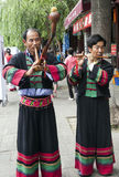 Chinese Ethnic Minority Musicians. Chinese ethnic minority men play traditional instruments in Dali, Yunnan province, China Stock Photo
