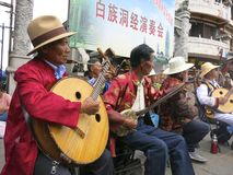 Chinese Ethnic People Perform Traditional Music -- Bai people in Dali, Yunnan perform music in a traditional band. Local Dali Bai performers put on a show Royalty Free Stock Photos