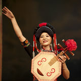 Chinese ethnic singer of Yi nationality. CHENGDU - SEP 26: chinese Yi ethnic singer performs on stage at JIAOZI theater.Sep 26,2010 in Chengdu, China Royalty Free Stock Photo