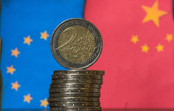 Chinese and European flags Euro coins Royalty Free Stock Image