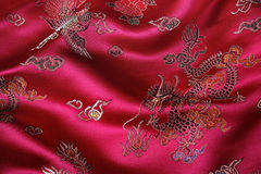 Chinese Fabric. Closeup of a red silky chinese fabric with oriental motifs Royalty Free Stock Photos