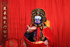 Chinese face masks art. Face-Changing(also face mask art) is an ancient Chinese dramatic art.This show is in a traditional Chinsee wedding royalty free stock photography