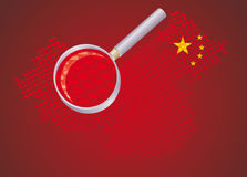 Chinese factories. Map of china made by little factories enlarged by a magnifying glass Stock Photos