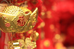 Chinese fake gold ingot. Chinese new year decorations.fake gold ingot best wishes for wealthy in the coming new year royalty free stock images