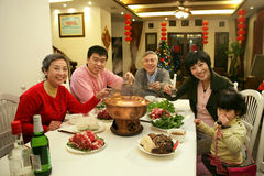 Chinese family at dinner table Royalty Free Stock Images