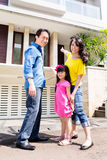 Chinese Family in front of house Royalty Free Stock Photo