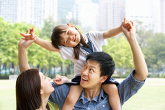 Chinese Family Giving Daughter Ride On Shoulders