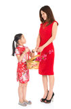 Chinese family holding a gift basket Royalty Free Stock Image