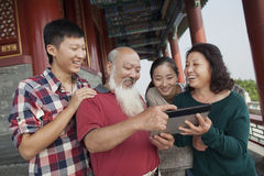 Chinese Family Looking At Digital Tablet In Jing Shan Park Stock Images