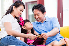 Chinese family online shopping with tablet computer Royalty Free Stock Photography