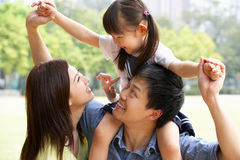Chinese Family In Park With Daughter Stock Image