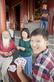 Chinese Family Playing Card In Jing Shan Park Royalty Free Stock Photos
