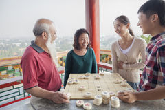 Chinese Family Playing Chinese Chess (Xiang Qi) Royalty Free Stock Images