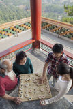 Chinese Family Playing Chinese Chess (Xiang Qi) Stock Photography
