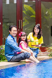 Chinese Family at pool in front of home Stock Images