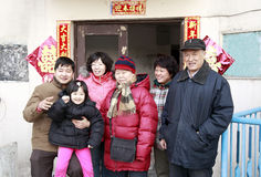 Chinese family portrait. An ordinary Chinese family portrait in front of their home during new year. Chinese couplet on the wall means Double Happiness,Happy new stock photos