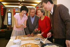 Chinese family reunion in the house Stock Photos