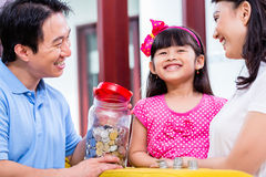 Chinese family saving money for college fund stock image
