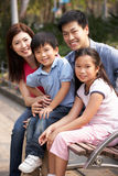 Chinese Family Walking Sitting On Bench In Park Stock Image