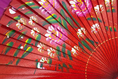 Chinese fan. Chinese red wooden fan on the white Royalty Free Stock Photography
