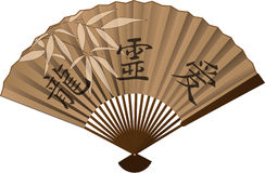 Chinese fan. A Chinese bamboo fan with leaves Royalty Free Stock Image