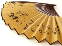 Chinese fan. Beautiful chinese fan fragment decorated with hieroglyphs Royalty Free Stock Photo