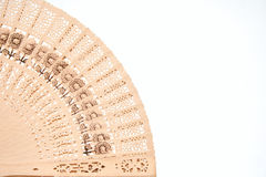 Chinese fan. Close-up of an open decorative Chinese wooden fan isolated on a white background Royalty Free Stock Photography