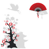 Chinese fan and flowering tree Royalty Free Stock Photo