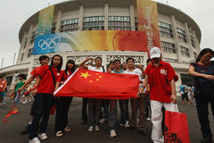 Chinese fans display flag Olympic Stadium Beijing Royalty Free Stock Photography