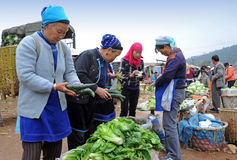 Chinese farmers sell their goods on the market Stock Images