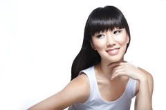 Chinese fashion beauty model looking radiant. Chinese fashion model with porcelain skin and cheerful smile glances sideways. Copyspace on left great for skincare Stock Photography