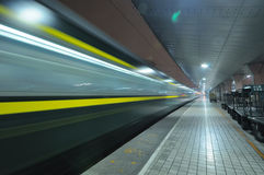 Chinese fast train pass railway station royalty free stock images