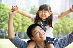 Chinese Father Giving Daughter Ride On Shoulders Royalty Free Stock Photography