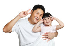 Chinese father making victory signs with daughter. Young Chinese father posing with daughter making victory signs with their hands, happily smiling looking at Stock Photo
