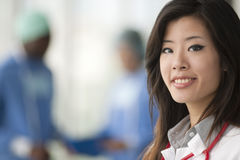 Chinese female doctor. Surgeons on backgrounds Royalty Free Stock Photo