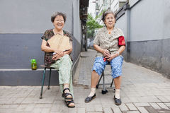 Chinese female elderly in Beijing old town, China Royalty Free Stock Image