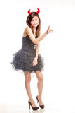Chinese female in frilly black dress and devil horns pointing fi Royalty Free Stock Photos