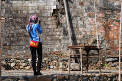 Chinese Woman Photographer. Chinese Female photographer in front of old wall Royalty Free Stock Photos